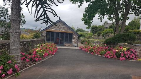 Linda cabana convertida de um antigo estábulo.
