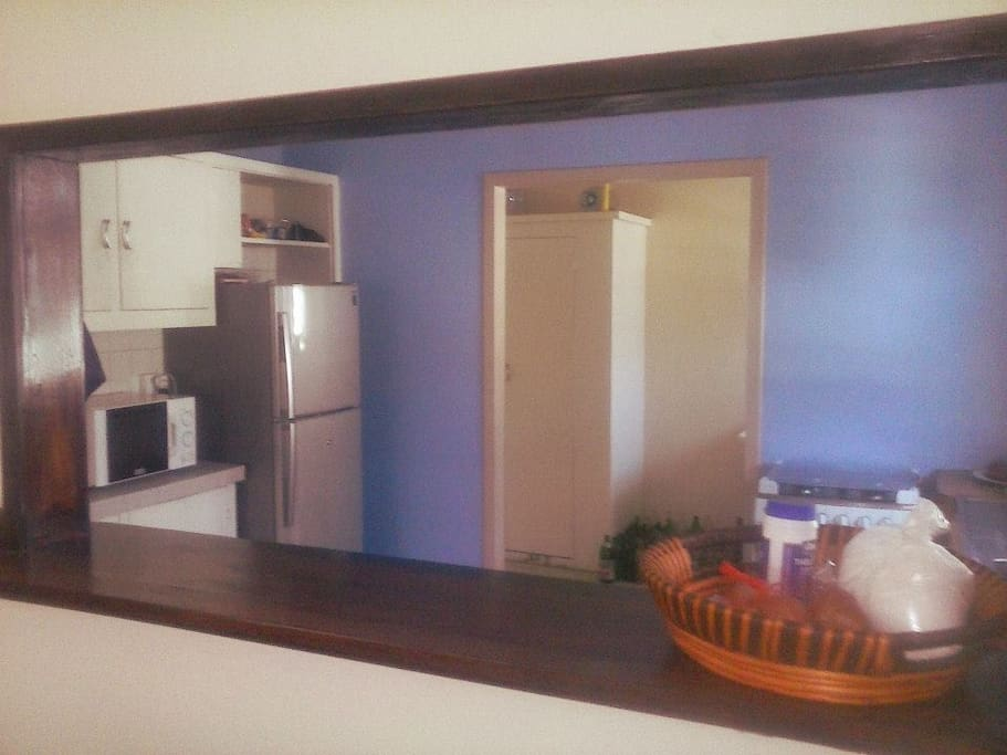 Kitchen with Gas Oven, Microwave & Fridge