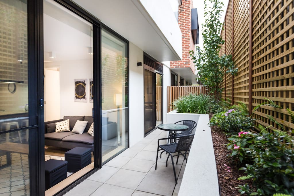 Living area has sliding doors which open to a private courtyard