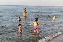 Water is shallow for quite a bit, so it is safe for kids to swim and play