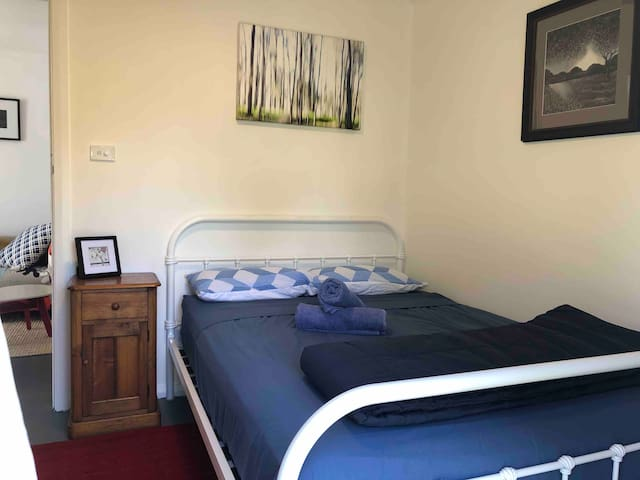 Bedroom with double bed and access to yard