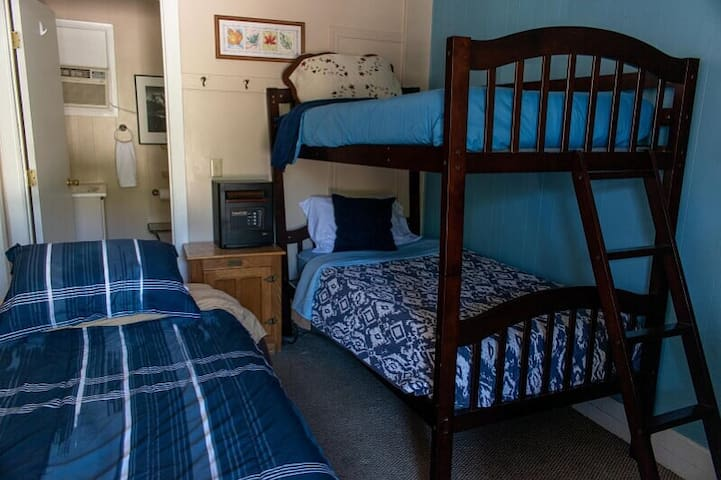 Room 8 features a twin bed and twin bunk, plus a larger bathroom.