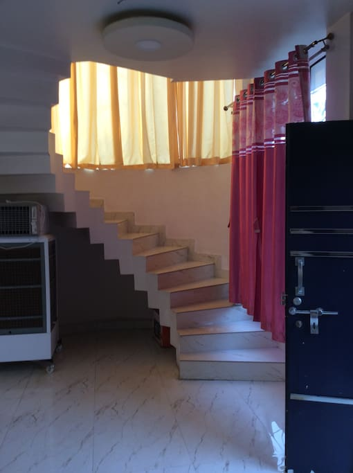 Stairs to to upstairs to the floor