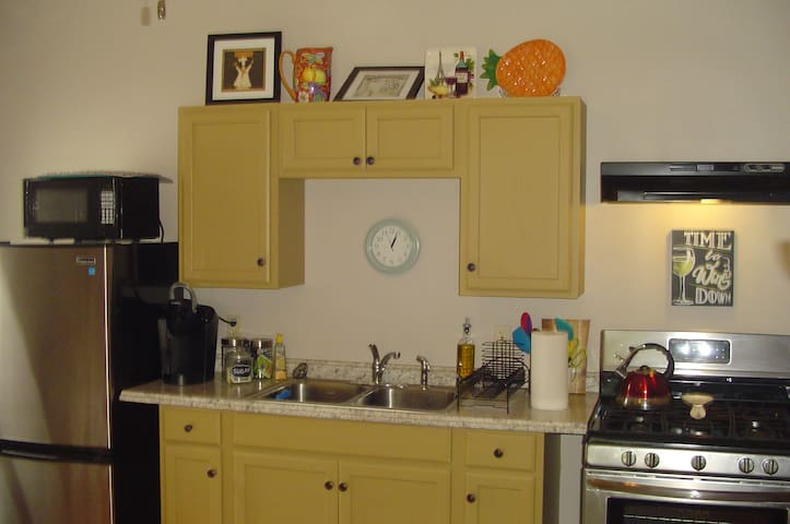 Keurig Coffee maker, microwave, gas stove, and refrigerator. Assorted coffee, tea, and snacks!