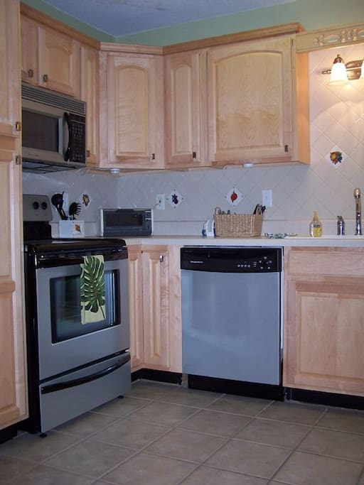 Kitchen ~ pots, pans, utensils, dishes, coffee pot are all provided for your convenience.