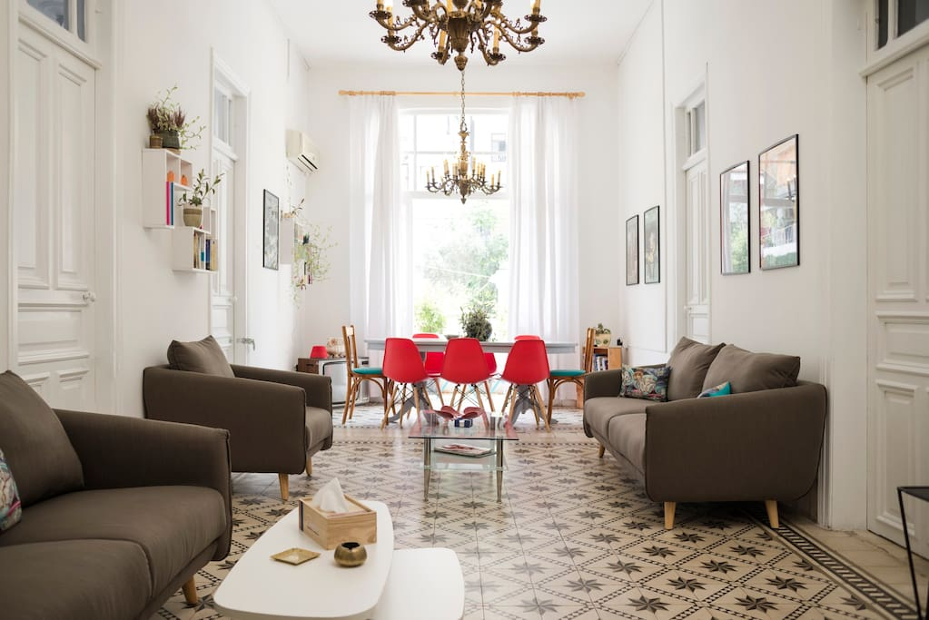 The living room is bright and spacious, with plenty of room for all guests to relax after a long day walking around town.
