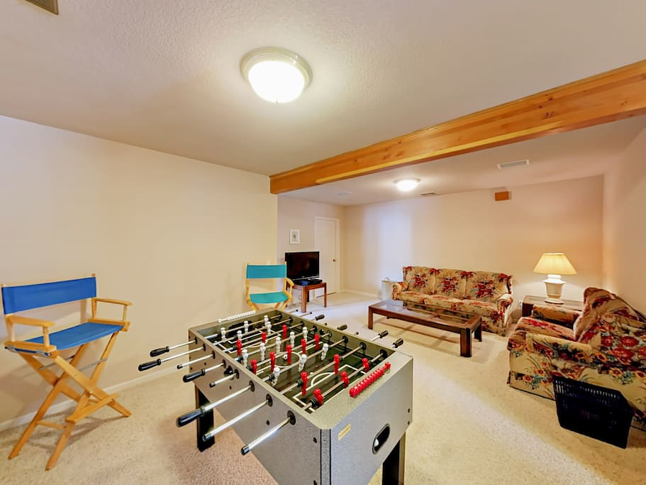 "The lower-level 2nd living area offers a foosball table, 40"" flat screen TV with DVD player, couch and loveseat."