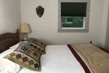 Queen bed with high quality sheets. Choice of pillows. Terry robes. Extra blankets.