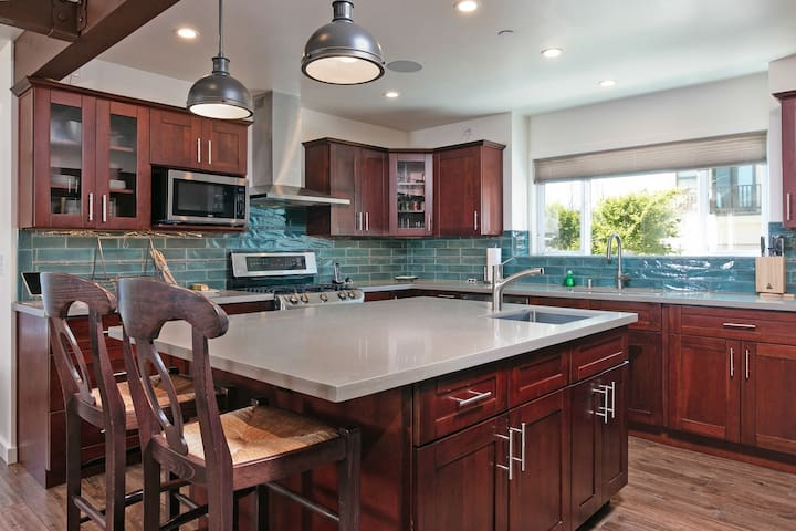 A large island in the kitchen provides ample prep space.