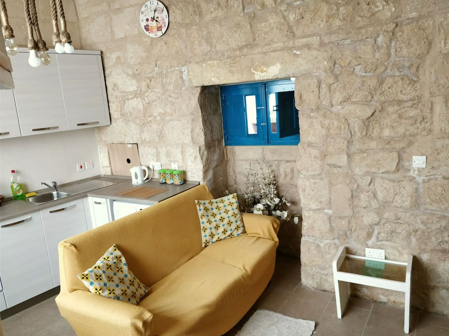 kitchen & living made of unique Maltese stone but having all the modern comforts and necessities...while giving that village core expertise
