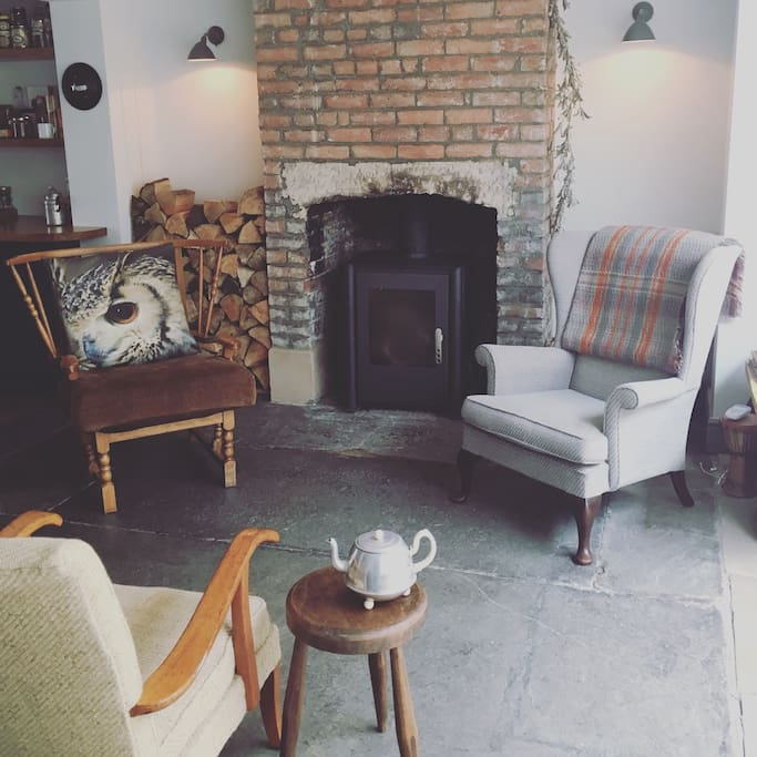 Sit with a pot of tea and relax in our open sitting room. (We have new chairs but no photo)