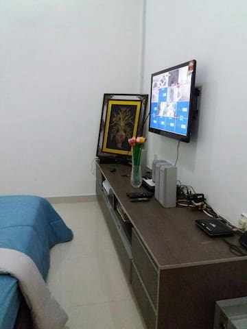 Bedroom of 11 feet x 10 feet with SONY flat screen 35 inches TV and blu ray disc player.