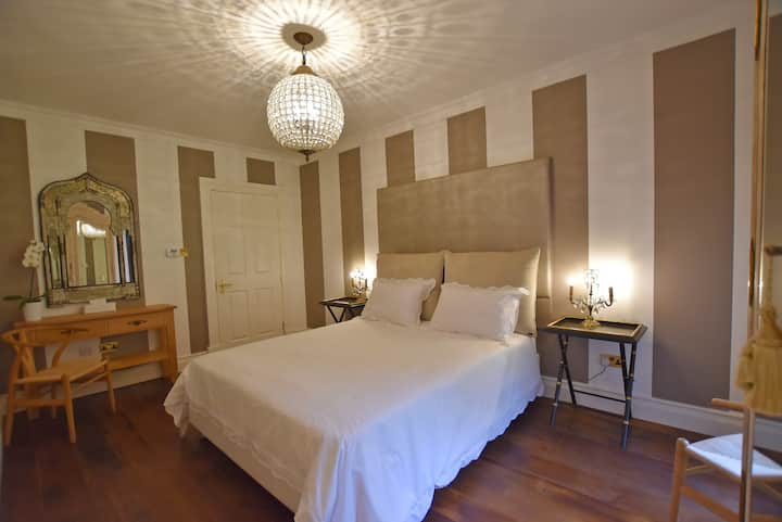 Large double bed in luxurious home with en-suit