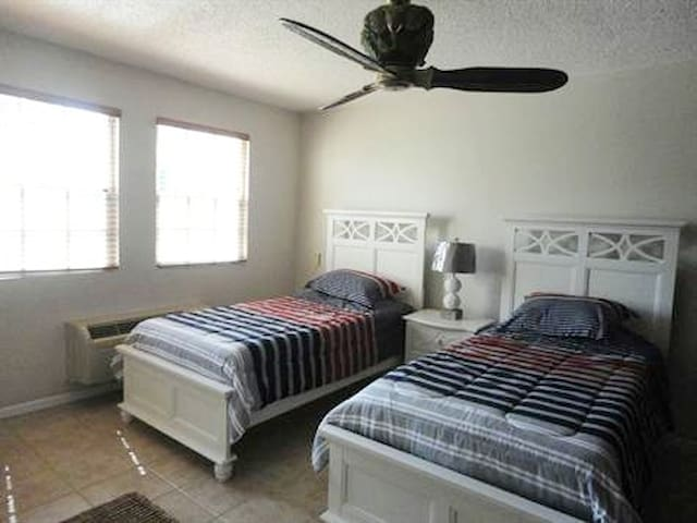 ::Bedroom with  two single/twin size beds convertible to a king size bed::