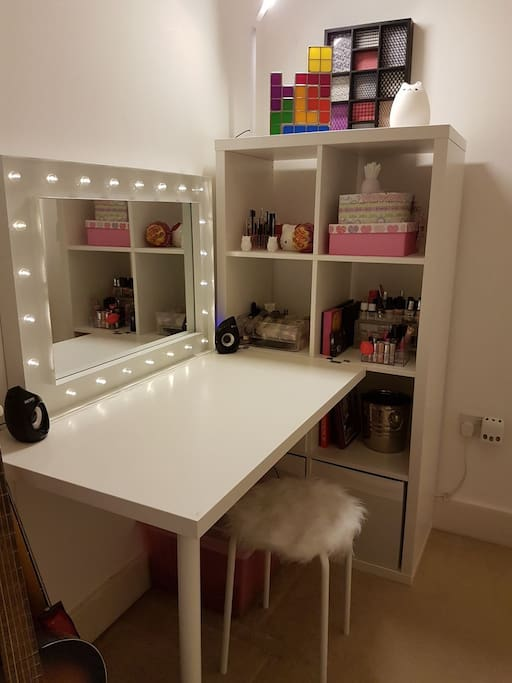 Dressing table/desk, with power points below.