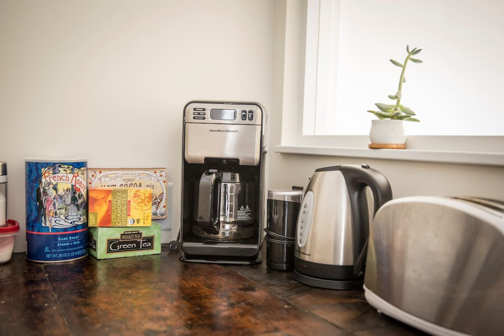 Coffee/Tea/Hot Cocoa provided. Coffee maker, grinder, electric water heater, toaster.