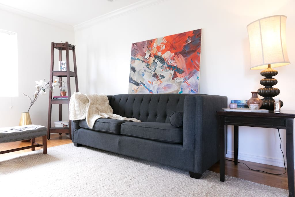 """Artsy and modern living room with a 50"""" smart TV."""