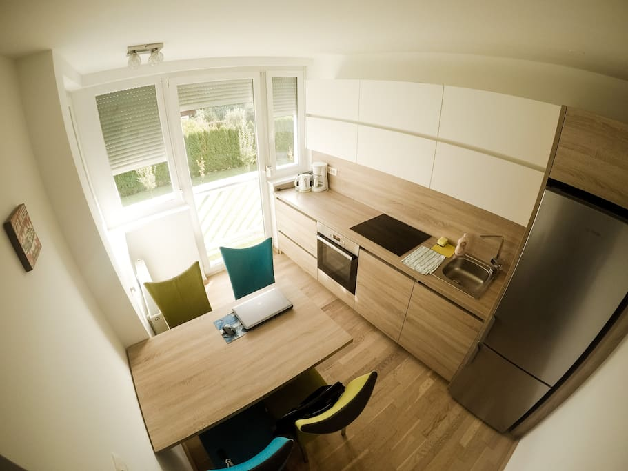 Kitchen (dish washer, sink, oven, 4 stoves, fridge and freezer) with dinning table