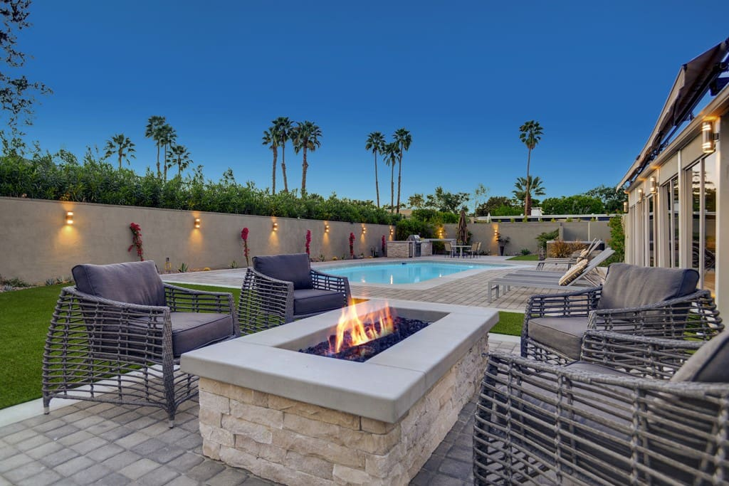 FIREPIT AND POOL NIGHT - THE CASCADES RETREAT - PALM SPRINGS VACATION RENTAL POOL HOME