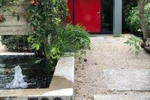 House number, fish pond and front door
