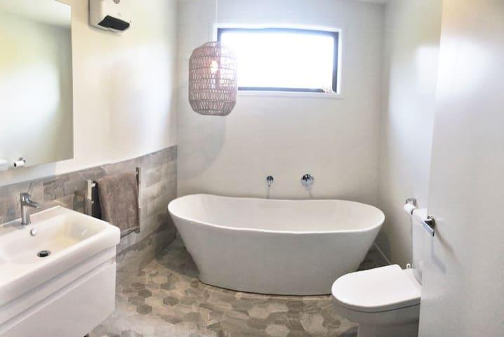 Main Bathroom of Main House - has shower and bath.