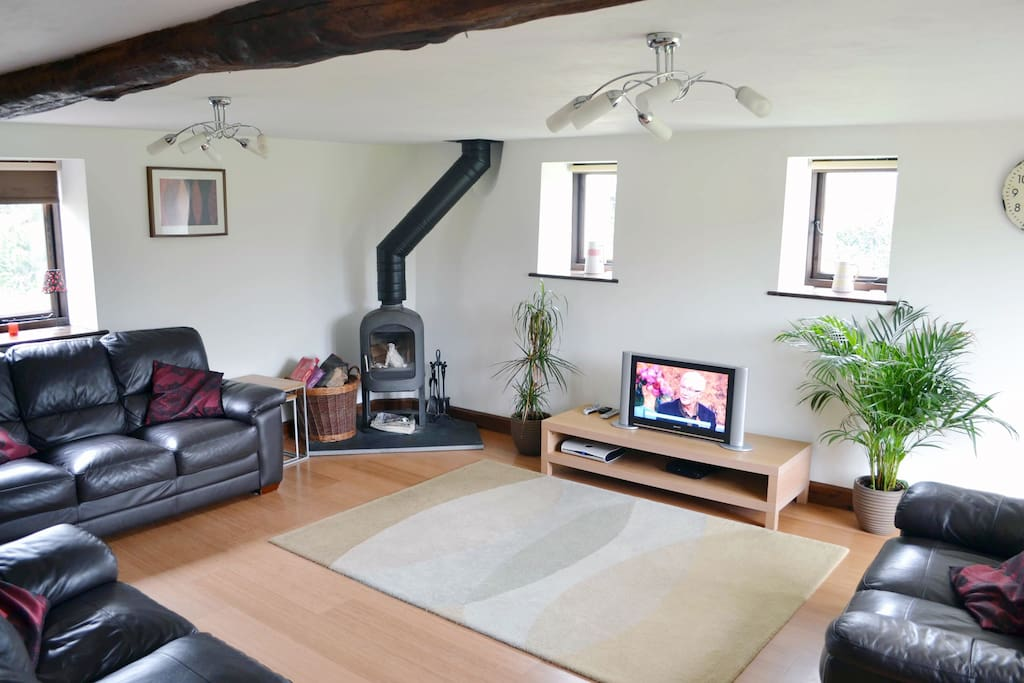 Ground floor: Large sitting room with a wood burning stove