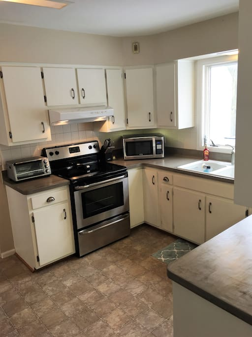 Kitchen-  Toaster oven, stove, and microwave. Plates, bowls, utensils, pots, pans and anything you may need to cook with provided.