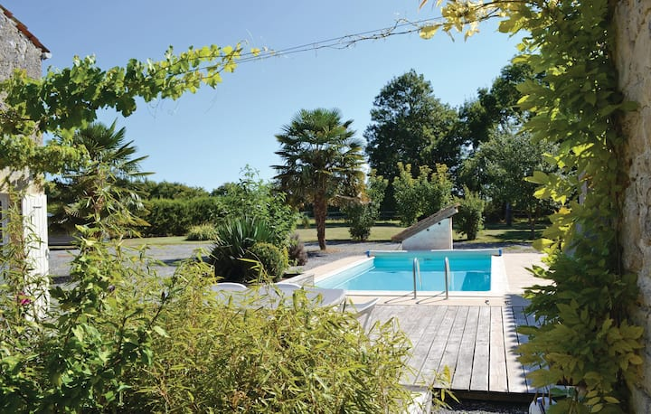 Nice home in Nuaille with Outdoor swimming pool and 3 Bedrooms