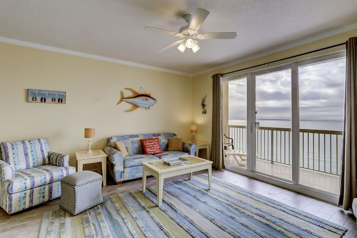 Sunny & airy condo w/ a full kitchen, furnished balcony, shared pools, & gym