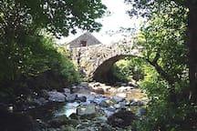 Whillan Beck Cottage behind 17th Century Packhorse Bridge