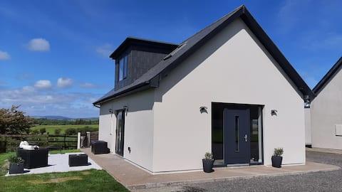 Moderni maja Länsi-Corkin sydämessä, Skibbereen