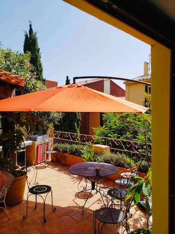 The terrace- private, spacious. 2 tables, 8 chairs, bbq/grill, boxed garden. Opposite the market place- pop downstairs for fresh produce to cook on the bbq or across the square for a bottle of local wine.
