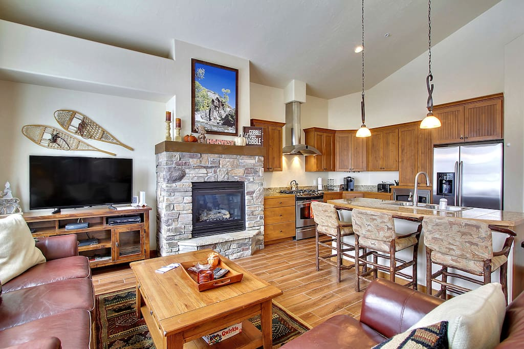 Cozy gas fireplace and flatscreen TV in lounge.