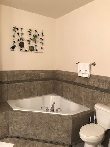 Large bathroom with jet tub