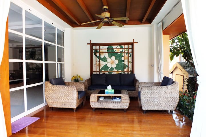 Outside Sofa And Chairs with Ceiling Fan To Keep Cool