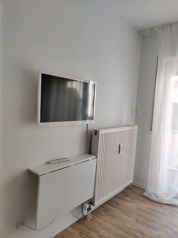 Smart TV and foldable desk