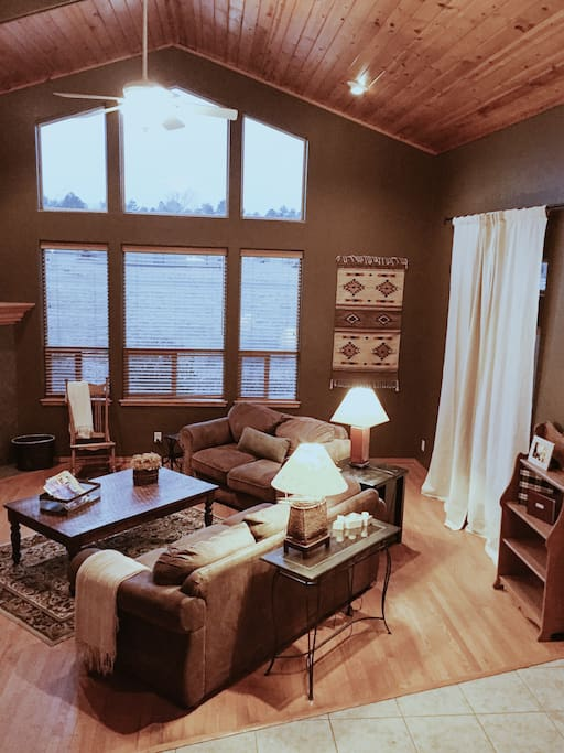 """Our living room overlooks the gorgeous San Francisco Peaks, and features a gas fireplace, 42"""" flat-screen TV, and ample seating."""