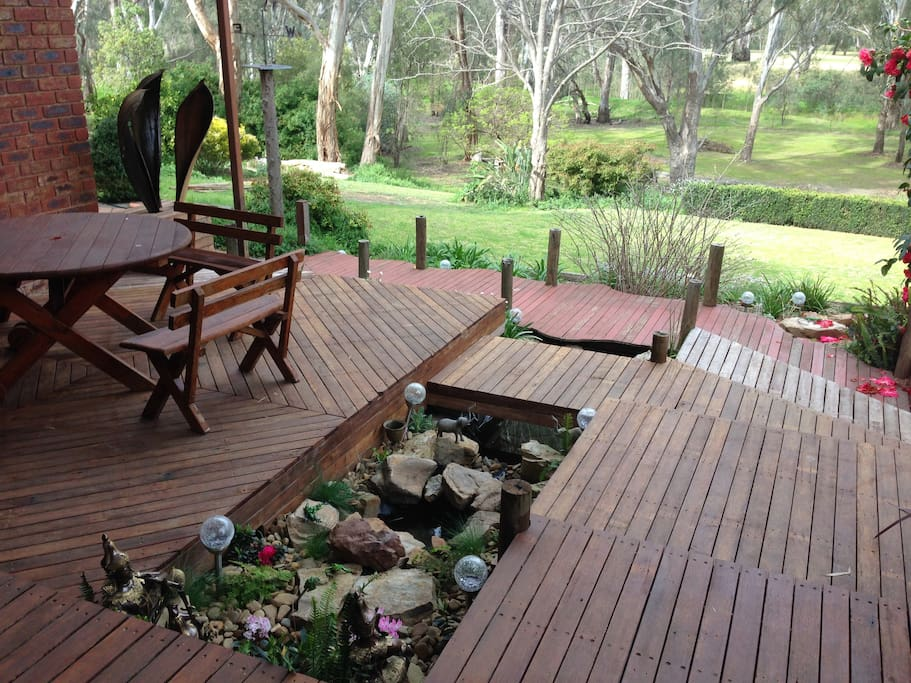 Wooden deck with water feature.