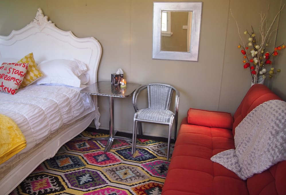 Bedroom one is a cabin with queen Anne Bed & click-clack couch & two seater cafe table can sleep up to four people