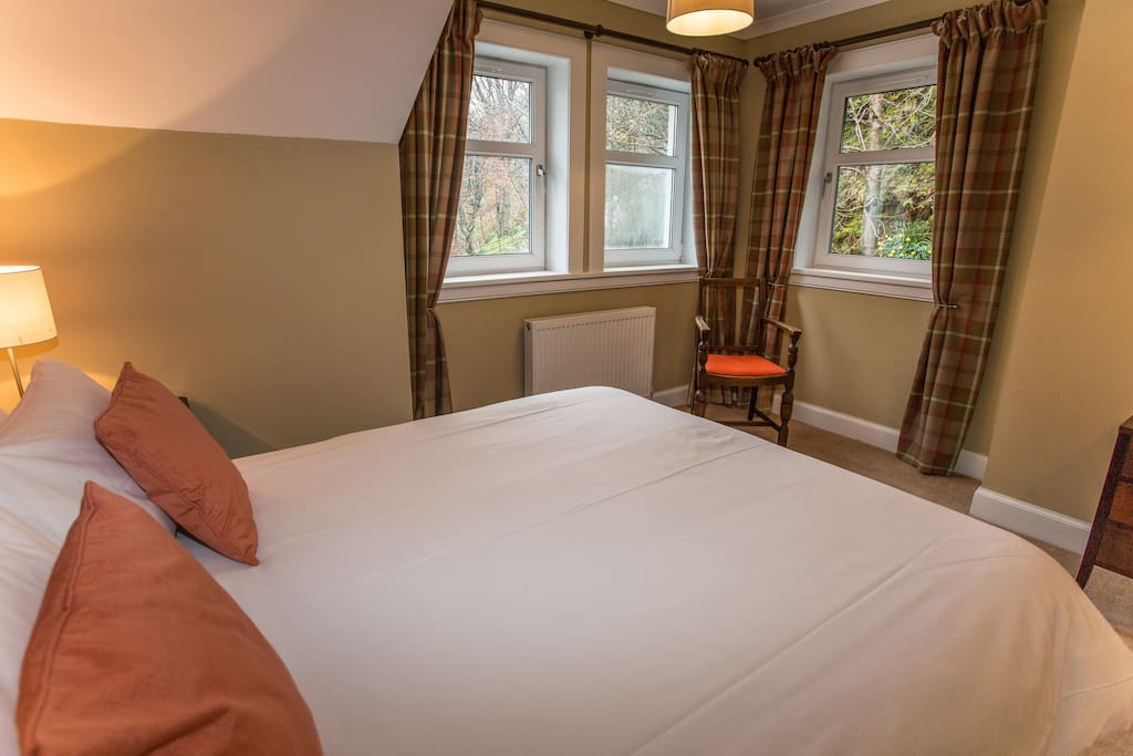 The suite enjoys dual aspect views out towards the sea and Lochranza Castle as well as our gardens and the trees where red squirrels nest