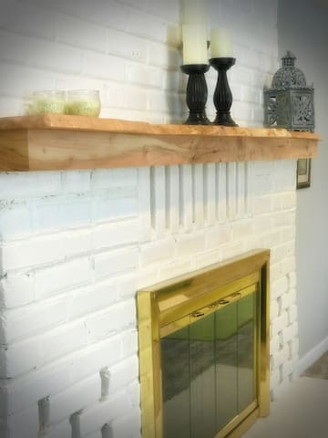 Flameless candles on our hand made PNW maple fireplace mantle, add warm light for quiet evenings home.
