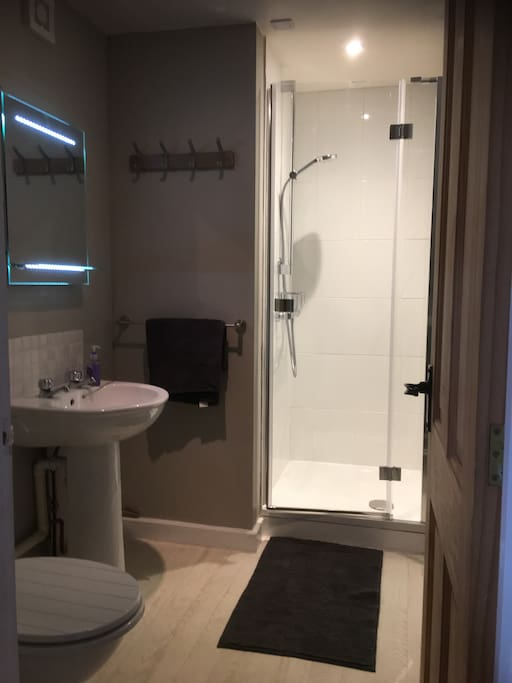 The bathroom with heated towel rail, mirror with demister pad, shaving point and sensor light. New shower with good pressure.