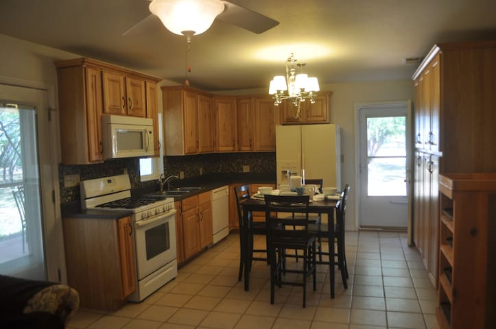 The kitchen is great for preparing food or eating out. We have added a Keurig coffee maker and a great selection of coffee.  There are pots, pans, dishes and silverware.  The window over the sink looks onto the porch and private back yard.