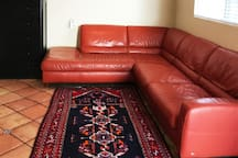Long, comfortable sofa can accommodate a third guest.