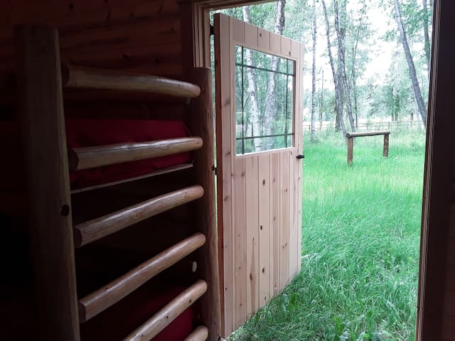 Bunk room to back yard.  One Bunk w/ 2 Singles (Weight limit upper level 150#)  AND One Full OR  2 Twins