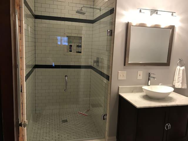 Walk-in shower with rainhead