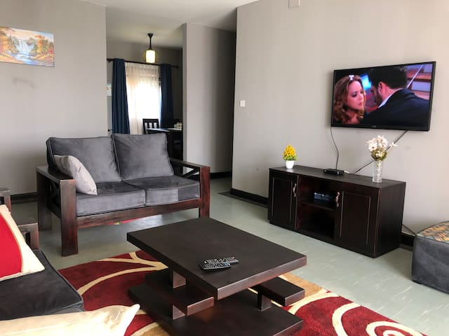 Spacious living room with cable tv and unlimited wifi.