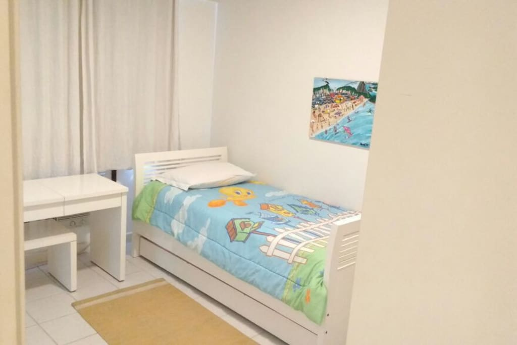 Guest bedroom with twin beds (one slides out from beneath the other).