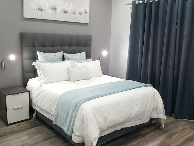 Spacious bedroom with orthopedic mattress and 'night-and-day' curtains.