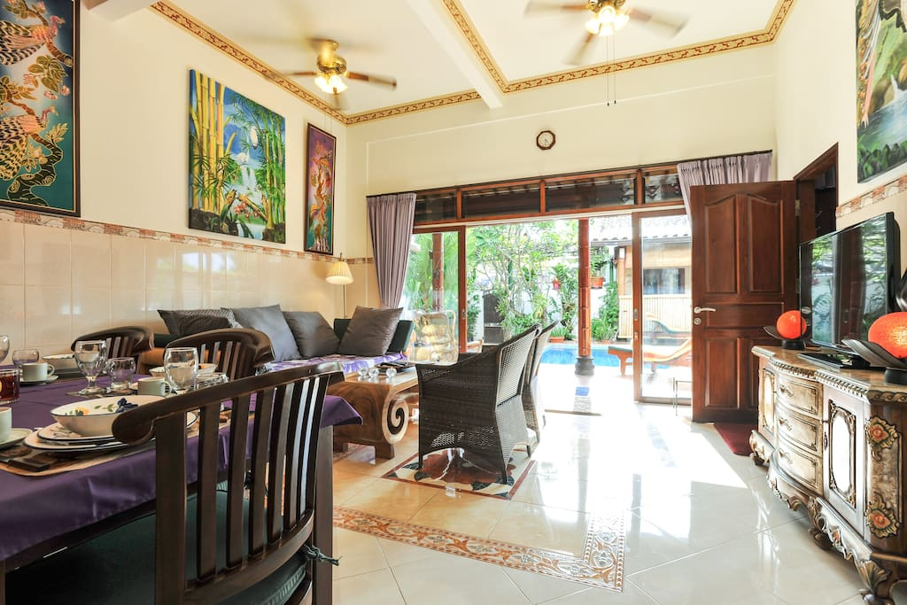 The cozy living room with direct access to terrace and your private pool - area.